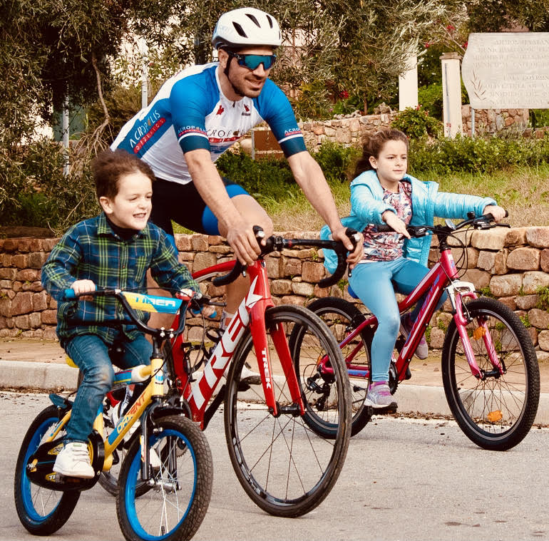 Acropolis organics photo of Olympic cyclist promoting active lifestyle and healthy living by cycling 2 children
